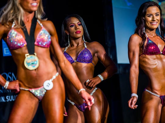 Jordan Beaubrin poses on stage in the bikini division of the NPC Greater Naples Classic National Qualifier at the Ritz-Carlton Golf Resort in North Naples on Saturday, Aug. 26, 2017.