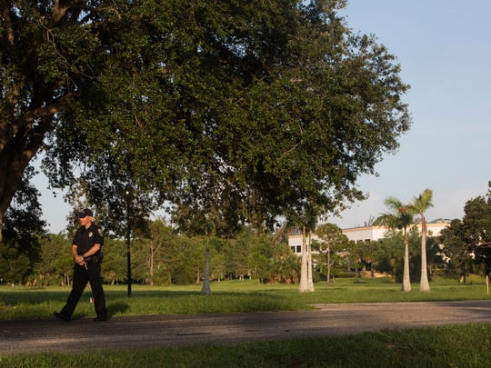 In this 2016 file photo, police guard the perimeter of the Naples Commons, where two bodies were found in the late afternoon of July 7, 2016, in Naples, Florida. The bodies were later identified as 18-year-old Xavier Sierra and 29-year-old John Vargas. Connie Serbu killed Sierra in a revenge scheme to avenge her daughter's molestation, a criminal complaint states.