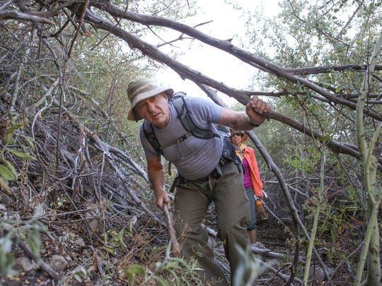 Gary Earney, a retired Forest Service employee, walks through the chaparral toward Nestle's water sources in the San Bernardino Mountains.