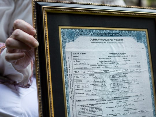 Shelley Binder holds her grandmother's birth certificate,
