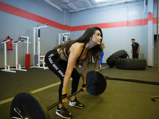 Celina Borunda demonstrates how to do a dead-lift at D.C. Body Personal Training & Fitness Gym. September 1, 2017.