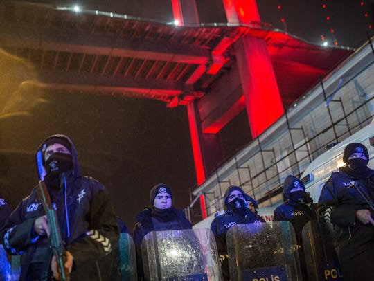 Turkish police secure the area at Ortakoy district