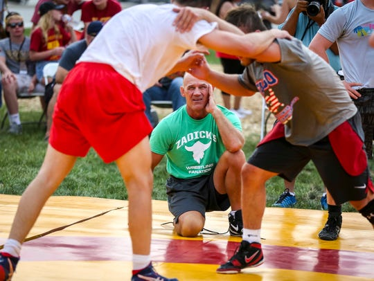 ISU wrestling coach Kevin Dresser watches members of