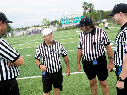 "Collier County sports official Carmine DeCianni shares a laugh with other officials in between games at Gulf Coast High School on Saturday, Aug. 26, 2017, in North Naples. DeCianni is waiting for a new kidney. ""I work full time. I officiate full time. Other than that, I'm on dialysis at home,"" DeCianni said."