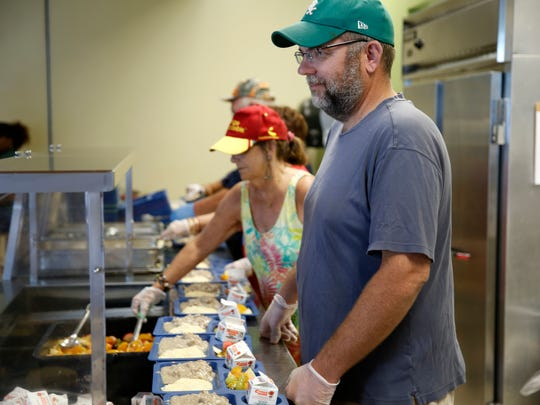 In honor of Labor Day, members of the Northwest Florida Federation of Labor volunteer to serve brunch at the Kearney Center Sunday, Sep 3.
