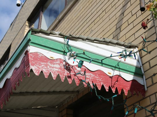 An awning of a building on Erie Street in Windsor's Little Italy displays the fading colors of the Italian flag.