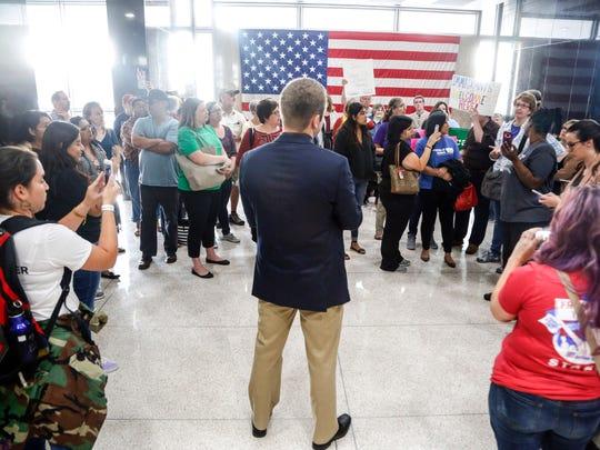 Immigrants rights activists speak with Matt Sexton,