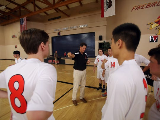 Coach Jack Makkai talks to the Palm Valley High School boys volleyball team before their first game, played against Victor Valley Christian on Tuesday, September 5, 2017 in Rancho Mirage.