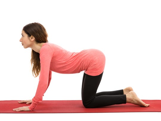 Woman doing cow pose during yoga