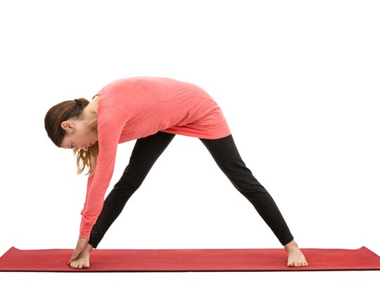 Woman doing sidebody stretch during exercise.