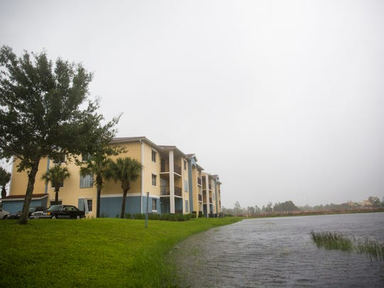 Water begins to pool in ditches and water levels rise in ponds near the Tuscan Isle Apartments on Sunday, September 10, 2017 as winds begin to pick up from Hurricane Irma.
