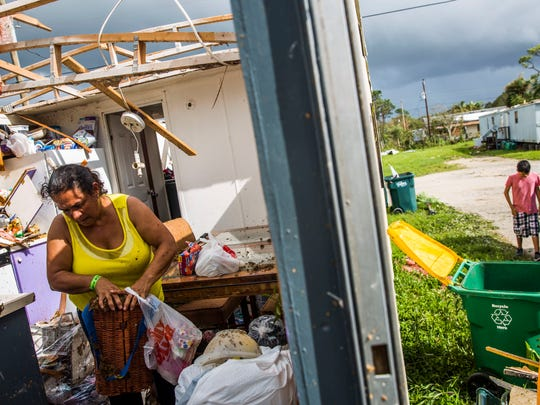 Leticia Magana cleans out her trailer the morning after Hurricane Irma ripped off her roof and destroyed the inside of her home in Immokalee on Monday, Sept. 11, 2017. The 7 people living in Magana's home will be staying at a relative's house in town.