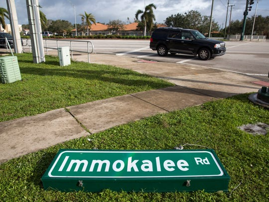 A street sign for Immokalee Rd was ripped to the ground by Hurricane Irma where it intersects Airport Pulling Rd N, in North Naples on Monday, September 11, 2017.