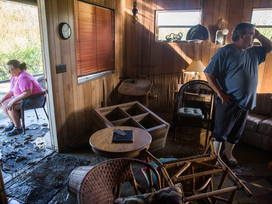 Robert Howard, right, and his wife Kathleen returned to their weekend home to find their furniture scrambled and the floor covered in a thick layer of mud in Plantation Island, an unincorporated area nearby Everglades City, as Collier County began picking up the pieces in the aftermath of Hurricane Irma on Tuesday, September 12, 2017.