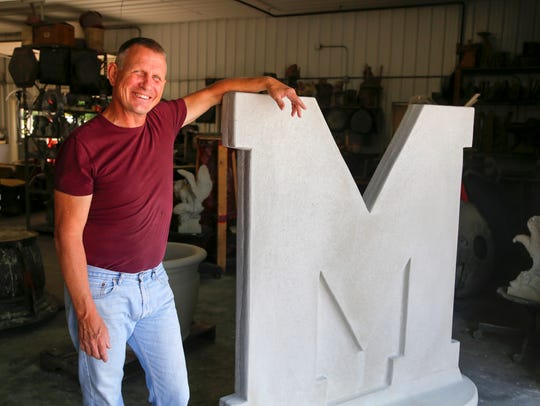 Dennis Meyer, owner of Created In Johnston stand for