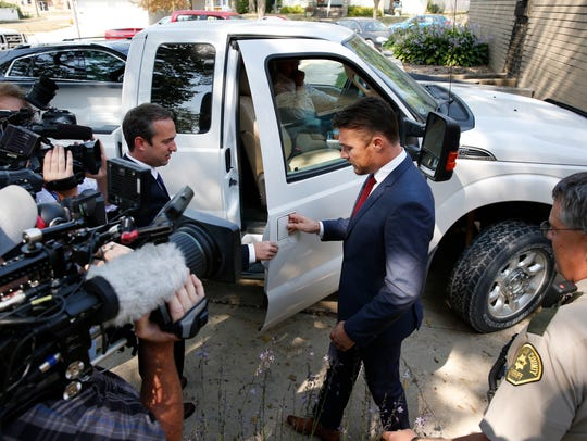 Chris Soules is escorted by his lawyer Brandon Brown