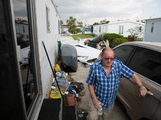 Ed Pearson, 78, stands outside his home in Naples Estates, a mobile home community off of Rattlesnake Hammock Road, shortly after shaking President Donald Trump's hand during a brief visit Thursday, September 14, 2017 in Naples, Fla. Pearson, whose home of 17 years flooded and had the roof ripped off due to Hurricane Irma, applied for federal assistance through FEMA early Thursday morning.