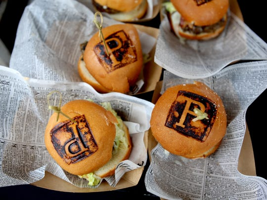 Signature Burgers at the Detroit Free Press Food & Wine Experience featuring Martha Stewart at Campus Martius Park in Detroit on Sept.16, 2017.