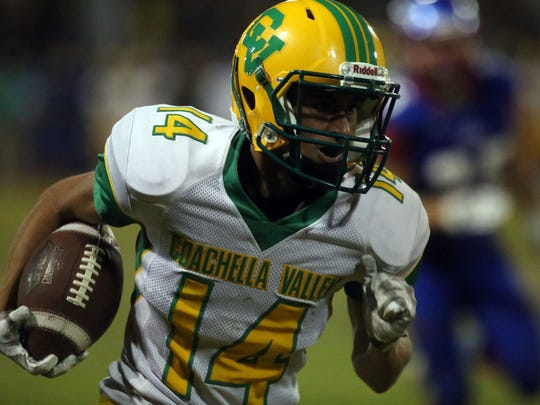 Coachella Valley's Jeremiah Perez carries the ball for a first down against Indio on Friday, September 15, 2017 in Indio, during the annual bell game.