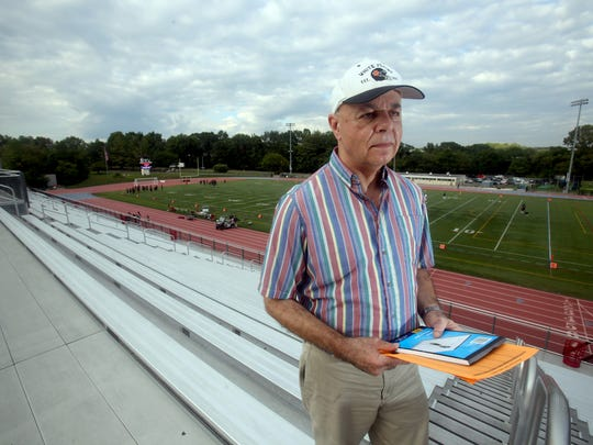White Plains sports historian Don Gano sits in the bleachers before a White Plains High School football game Sept. 15, 2017. Gano attended his first White Plains football game in 1959 at the age of ten. He says that except for a stretch in the Air Force, he has only missed two games since then.
