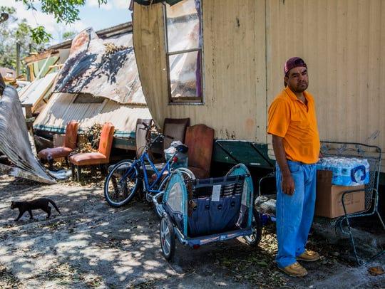 Nicolas Garcia, 36, outside of his destroyed Immokalee