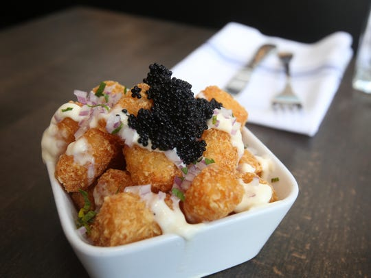 Tots with Creme Fraiche, Red Onion and Caviar, at The
