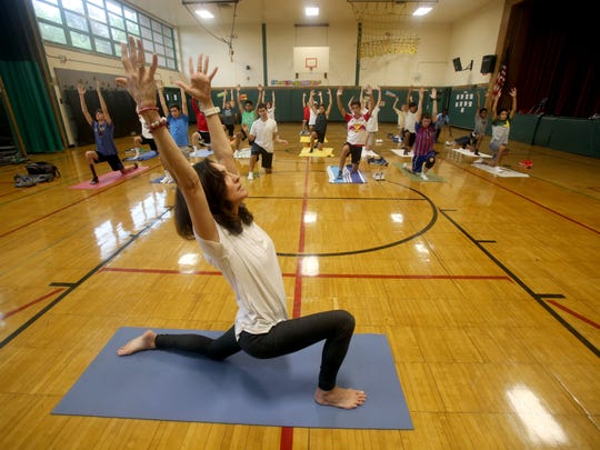 Yoga and meditation teacher Jennifer Monness leads
