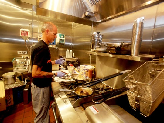 Eric Vathke, the new chef at Tapp in Tarrytown, cooks