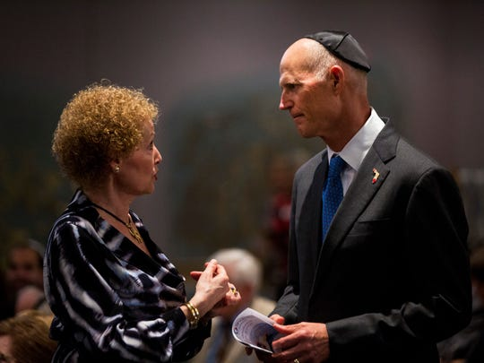 Gov. Rick Scott speaks with a member of the congregation before the start of the Rosh Hashana service at Temple Shalom in North Naples on Wednesday, Sept. 20, 2017.