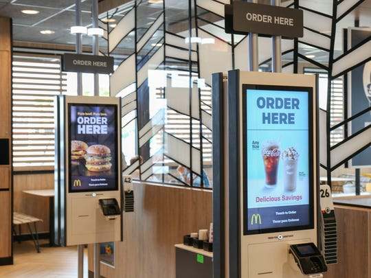 McDonald's restaurants have introduced kiosks with touch screen ordering. Two metro stores are offering the kiosks.