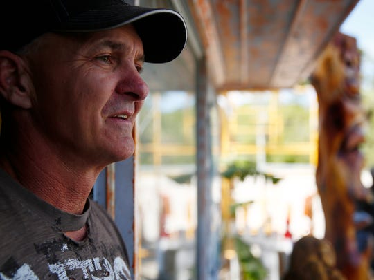 Michael Von Schroth, 51, of Dahlonega, Ga. and Naples talks during an interview Wednesday, March 9, 2016 at his roadside gallery at 19820 Tamiami Trl. E. studio in Collier County. With over 26 years experience the chainsaw sculptor has created a myriad of pieces over the years. He's trained a few apprentices, passing on his craft. He's in the process of making a 12 foot carving of sea life. (Corey Perrine/Staff)