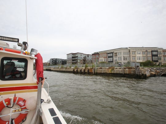 Tarrytown firefighter Miguel Valle takes the fireboat