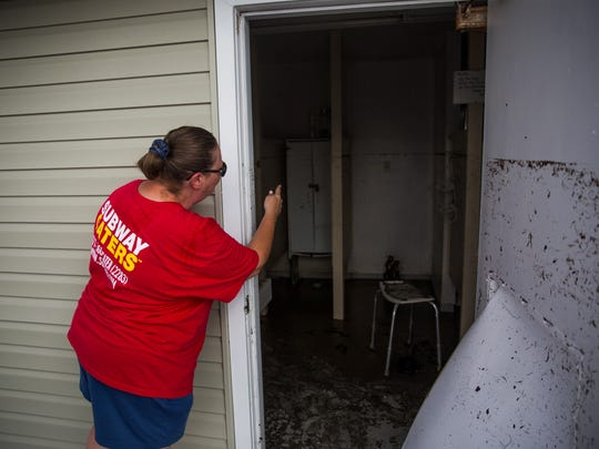 Carmen Kiefer, a resident of Fisherman's Cove RV Park, opens the door to the public bathroom on Thursday, September 21, 2017 in Everglades City.