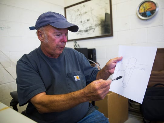 Tim Stephens, manager for the sewage plant, draws a