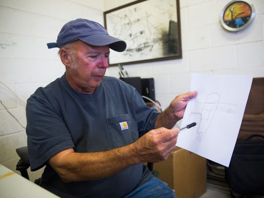 Tim Stephens, manager for the sewage plant, draws a diagram of the grinder septic tanks within the city on Thursday, September 21, 2017 in Everglades City.