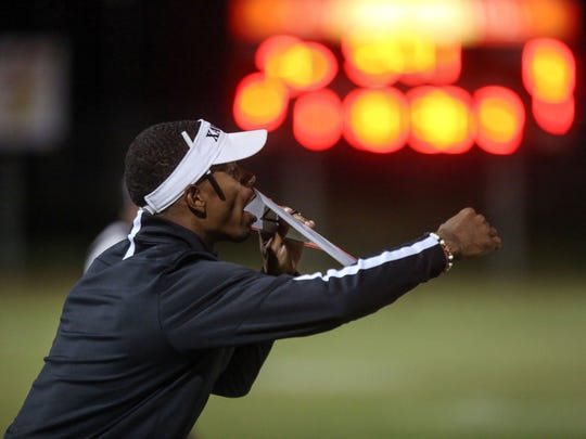Xavier Prep coach James Dockery gives instructions to his team during play with Palm Desert  on Friday, September 22, 2017 at Palm Desert High School.