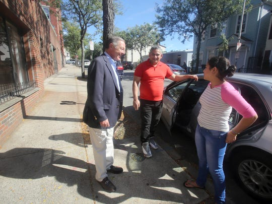 Billy Procida, president and CEO of Procida Funding & Advisors, left, speaks with Juan Veloz and his daughter Maria, 11, tenants in one of the apartment buildings he owns in Sleepy Hollow Sept. 22, 2017. Procida recently became a landlord of eight mixed-use buildings in the village after the properties former owner, who borrowed money from him, defaulted on the loan and filed for bankruptcy.