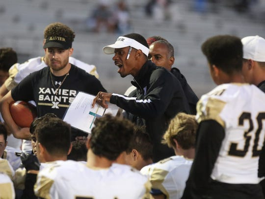 Xavier Prep coach James Dockery gives instructions to his team.