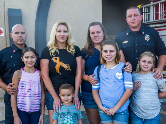 The Campbell and Mayberry families at Fire Station 61 on Sunday, Sept. 24, 2017. Both families lost their homes in Hurricane Irma.