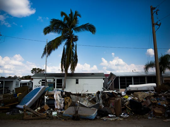 Ruined belongings and furniture sits on the side of the road outside of Fisherman's Cove trailer park on Thursday, September 21, 2017 in Everglades City.