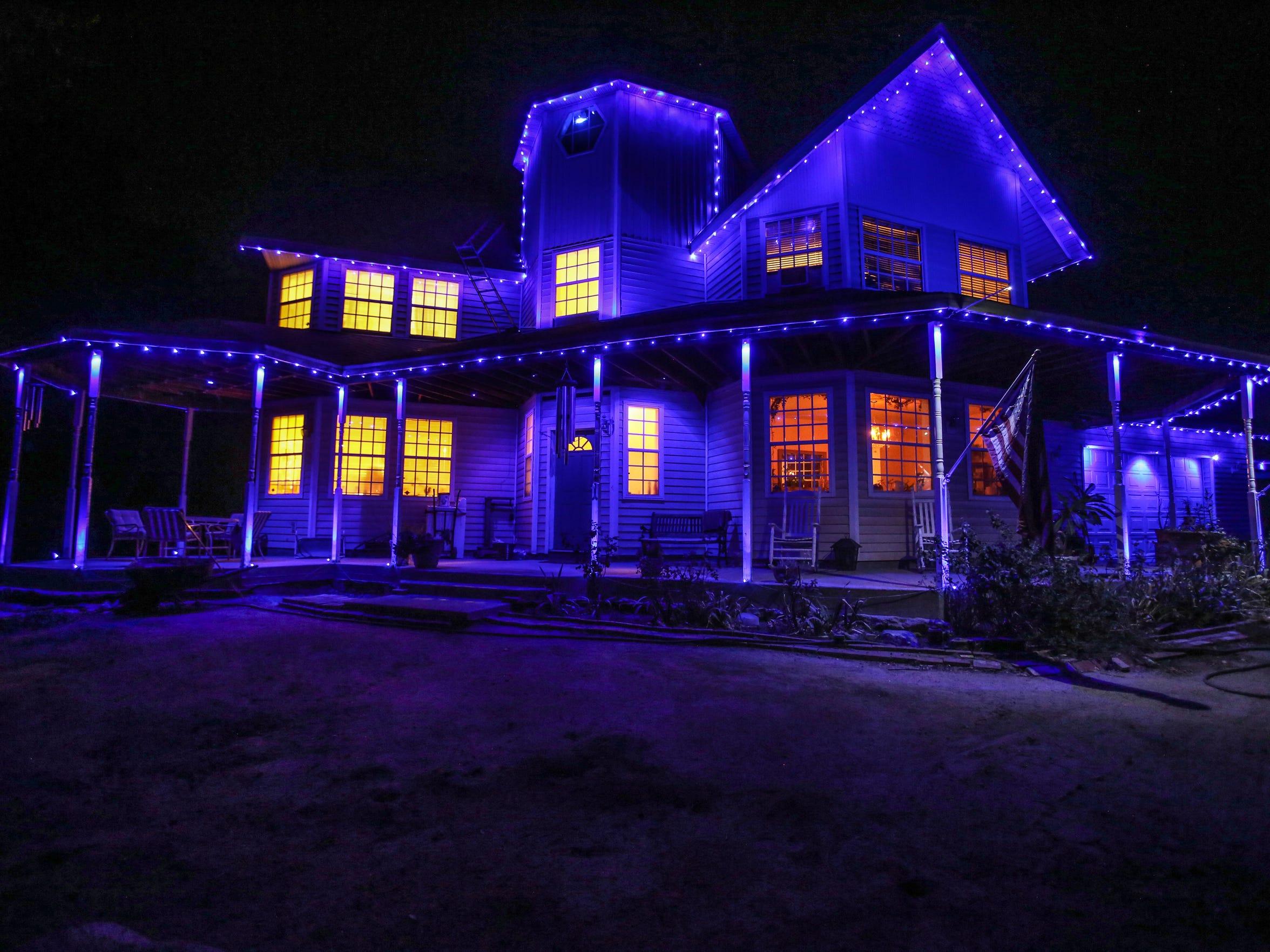David Kling lights his Hemet house in blue every night