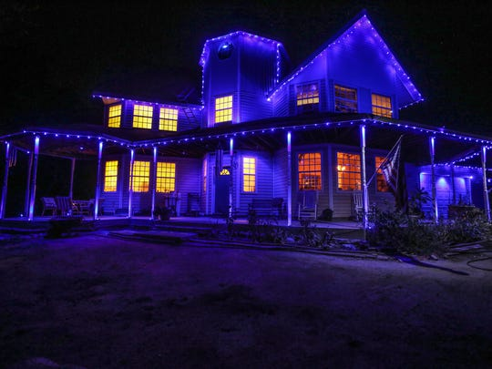 David Kling lights his Hemet house in blue every night in honor of his daughter, fallen Palm Springs police officer Lesley Zerebny.