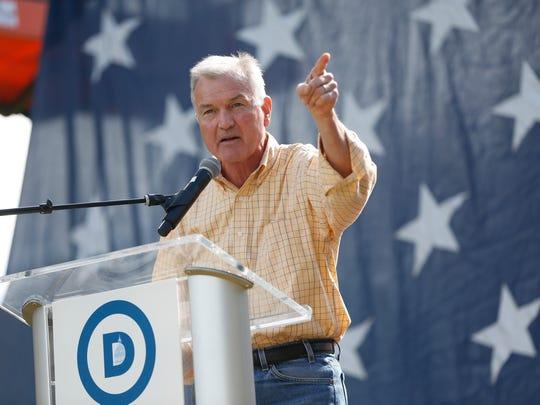 Democratic gubernatorial candidate John Norris speaks Saturday, Sept. 30, 2017, at the Polk County Steak Fry at Water Works Park in Des Moines.