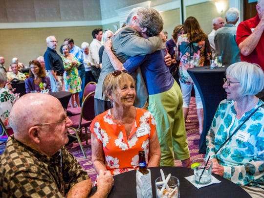 People greet each other during the Old Timers' Reunion at the Naples Beach Hotel & Golf Club on Sunday, Oct. 1, 2017.