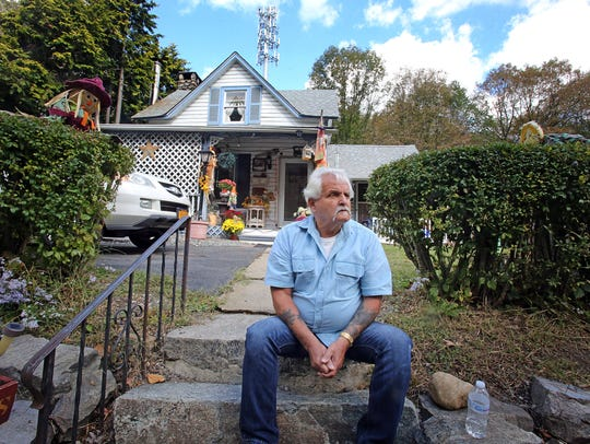 William Cuomo, sits in front of his two-story home where he has lived for 37 years at the end of Lake Street in Ramapo Oct. 3, 2017. Ramapo has issued eviction notices to tenants living in the Hamlets of Ramapo.