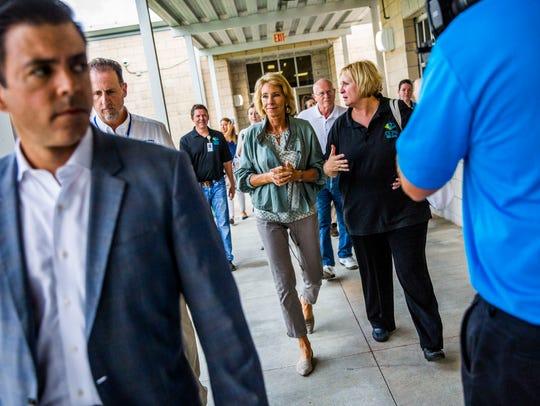 United States Secretary of Education Betsy DeVos walks