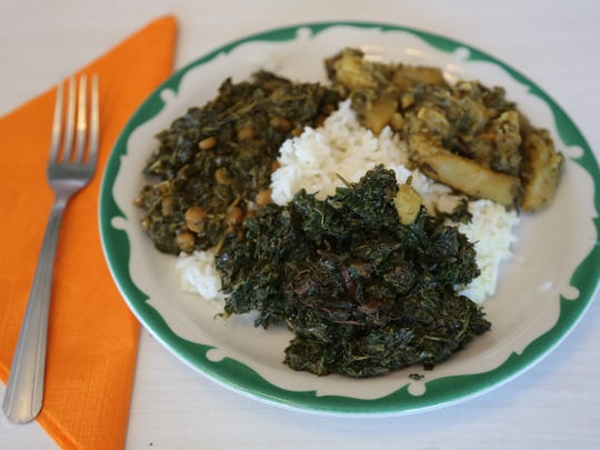 A plate of amaranth greens, potatoes and mint, and greens with lentils served over rice from a Bandhu Gardens pop-up at Rose's Fine Foods in Detroit.