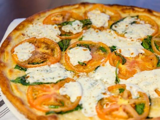 The heirloom tomato pizza from PJ's-SentryWorld restaurant