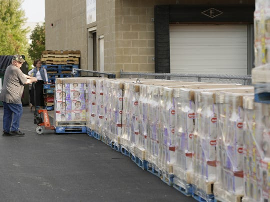 Gail  Table helps unload the diaper donation.  A half of a semitrailer with over 20 pallets of Kimberly-Clark diapers were donated to Oshkosh Community Pantry, September 25, 2017. Kimberly-Clark donated 442,704 diapers, which are being dispersed across the campaign's three sites.  Dollars for Diapers, a campaign undertaken by the Green Bay Press-Gazette, Appleton Post-Crescent and Oshkosh Northwestern, from its partner Kimberly-Clark Corp.  Joe Sienkiewicz / USA TODAY NETWORK-Wisconsin