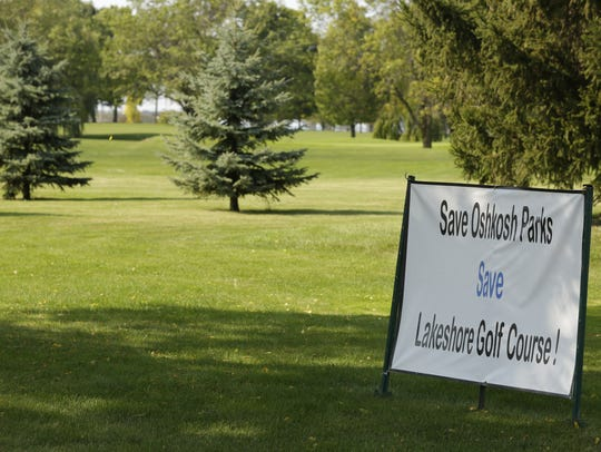 "A sign urges visitors to ""Save Oshkosh Parks: Save"